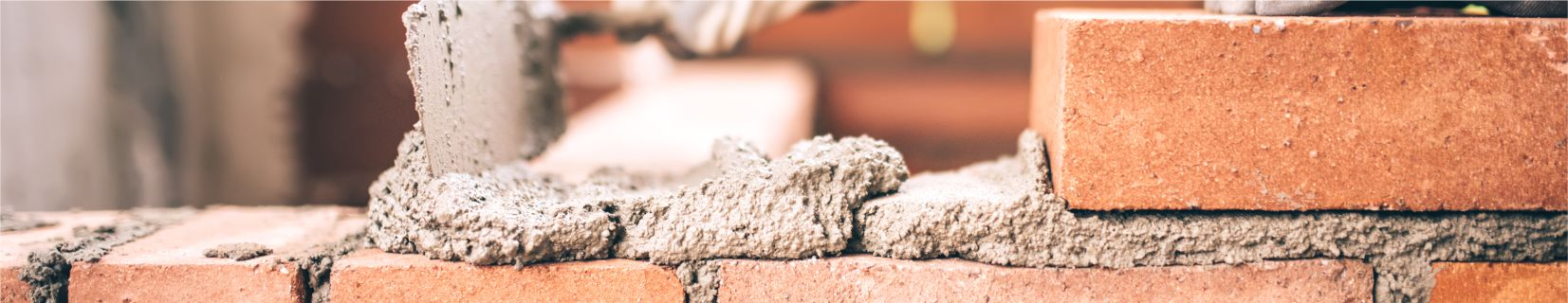 Builder Building a Brick Wall