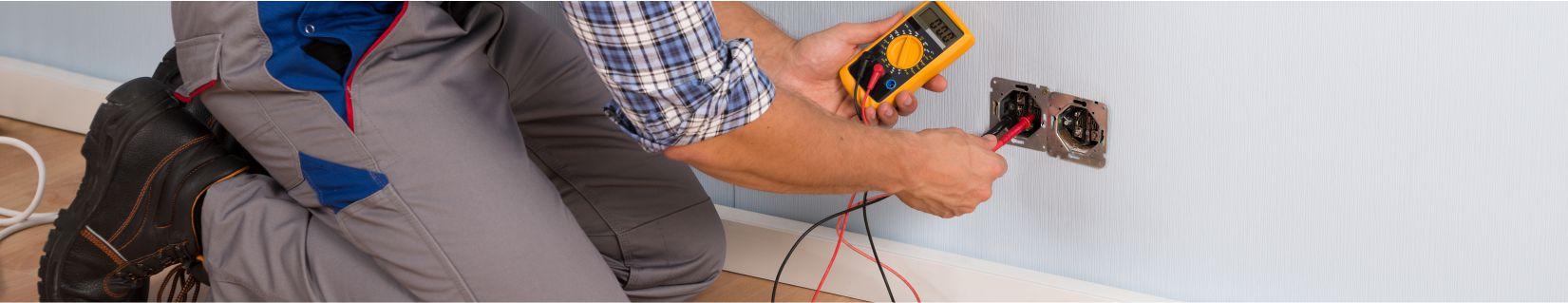 Electrician Testing a Wall Plug